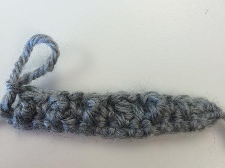 For Row 3, do a regular single crochet row. (Picture shows the wrong side, after you have done the single crochet row and turned the work.)