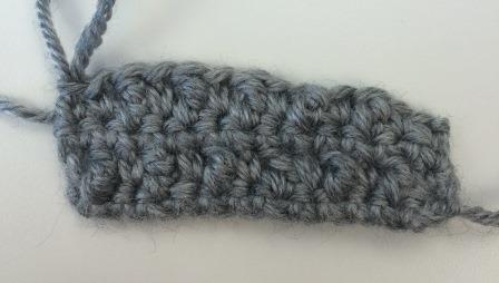 For Row 5, copy Row 3 and do a regular single crochet row.  Continue doing Rows 2-5 seven more times, and then do Rows 2 and 3 again. You'll end up with a square with a textured surface from the treble crochets sticking out.