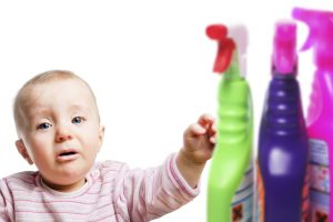 Infant child with cleaning chemicals